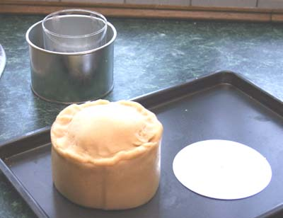 Pie released from bottom of tin