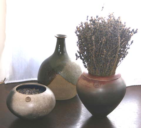 My bottle lurking behind two of Hugh's wonderful raku pots
