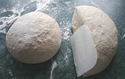 The dough halved for the first time using the scraper