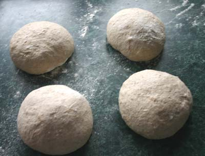 The dough halved and rounded into four pieces